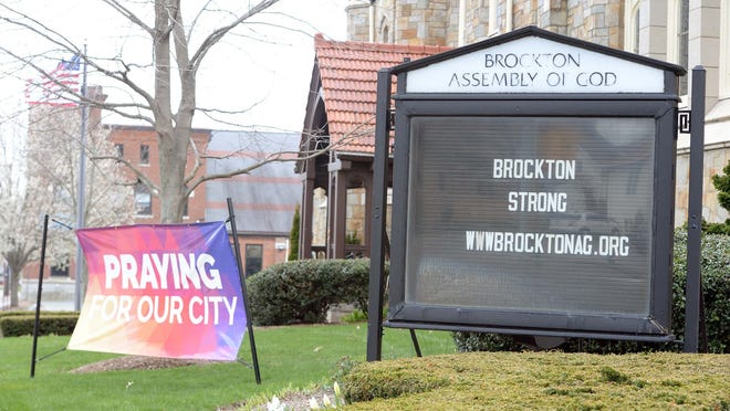 "FILE - In this Wednesday, April 22, 2020, file photo, signs outside the Brockton Assembly of God Church on Warren Avenue say ""BROCKTON STRONG"" and ""PRAYING FOR OUR CITY"" as the city is in the midst of the coronavirus pandemic and one of the hot spots in Massachusetts."