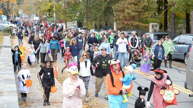FILE - In this Oct. 28, 2018, file photo, children and families participare in the Easton Halloween Parade. Trick-or-treating and Halloween events will look much different in 2020 amid the coronavirus pandemic.