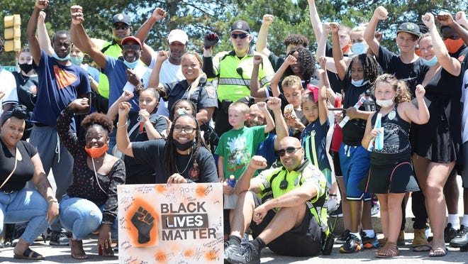 Black Lives Matter youth protest in front of Brockton Police Department on Friday, June 19, 2020.