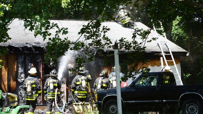 Detached garage fire at 1859 Broadway Street in Raynham on Thursday, June 18, 2020.