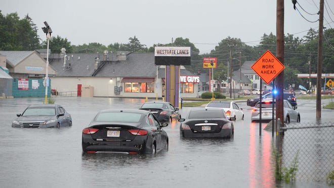 Brockton firefighters help people trapped in cars by flood on Westgate Drive on Sunday, June 28, 2020.