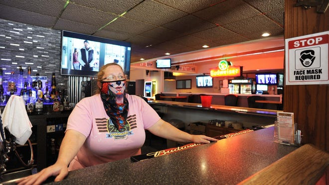 Terri, a bartender at Home Cafe, at 677 North Main St. in Brockton, on Tuesday, June 23, 2020, which has reopened for indoor dining.