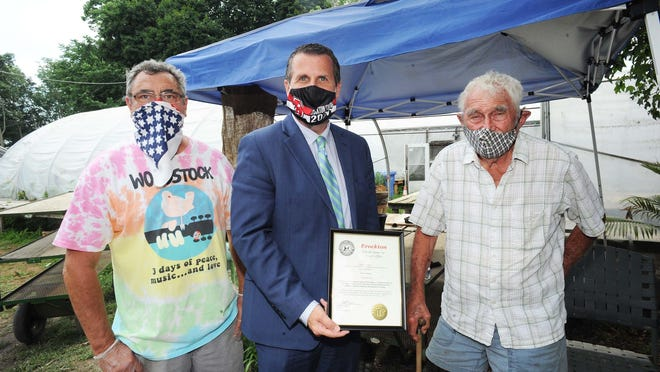 From left, Chris Gerry, Brockton Mayor Robert Sullivan, and Jospeh Gerry, owner of Gerry's Farm, who was honored with a citation for his family farm in business for 100 years,  on Thursday, July 30, 2020.