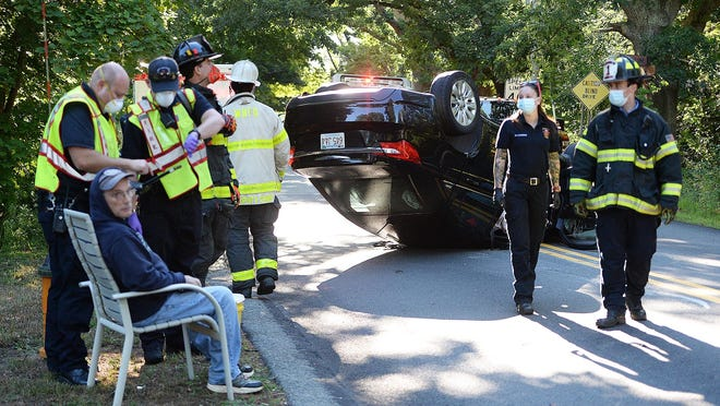 The driver of the car sitting in a chair that landed on its roof after a collision with J. Mather Landscaping truck on Purchase Street in Easton, Thursday, Aug. 20, 2020.