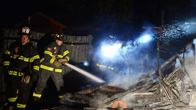 A shed fire damaged two homes on Kenwood Drive in Whitman on Thursday, Oct. 8, 2020.