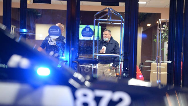 Brockton and state police detectives assigned to the Plymouth County district attorney's office investigate a fatal shooting at the Super 8 hotel on Westgate Drive in Brockton, Friday, Oct. 23, 2020. It's the city's fourth homicide of the year.