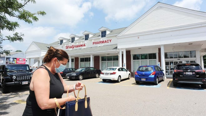 Carolyn Prohovich, of Bridgewater, shopping at Walgreens4 Central Square, Bridgewater on Thursday. Last Friday, a man pulled a gun on another man who had not worn a mask at the drug store, police say.
