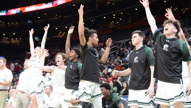 Abington players celebrate during their Division 4 state semifinal win over Snowden at TD Garden, on Tuesday, March 10, 2020.