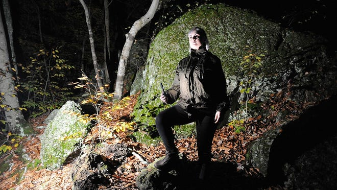Taunton Daily Gazette staff reporter Susannah Sudborough visits Anawan Rock in Rehoboth, said to be a Bridgewater Triangle hot spot, on Wednesday, Oct. 21, 2020.