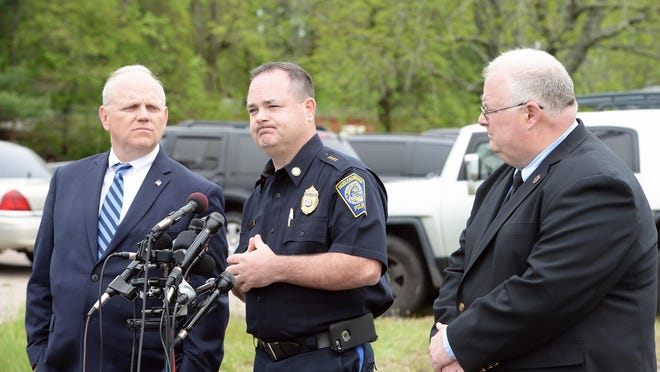 In a May 16, 2018, file photo, Middleboro Police Chief Joseph Perkins, center, speaks near the scene where a SWAT team was called for a barricaded person on Wareham Street. He is flanked by Plymouth County District Attorney Timothy Cruz, left, and Plymouth County Sheriff Joseph McDonald.