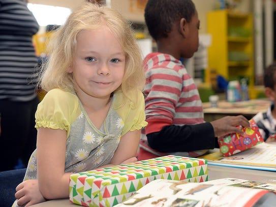 First grader Grace Spigelmoyer received a gift along