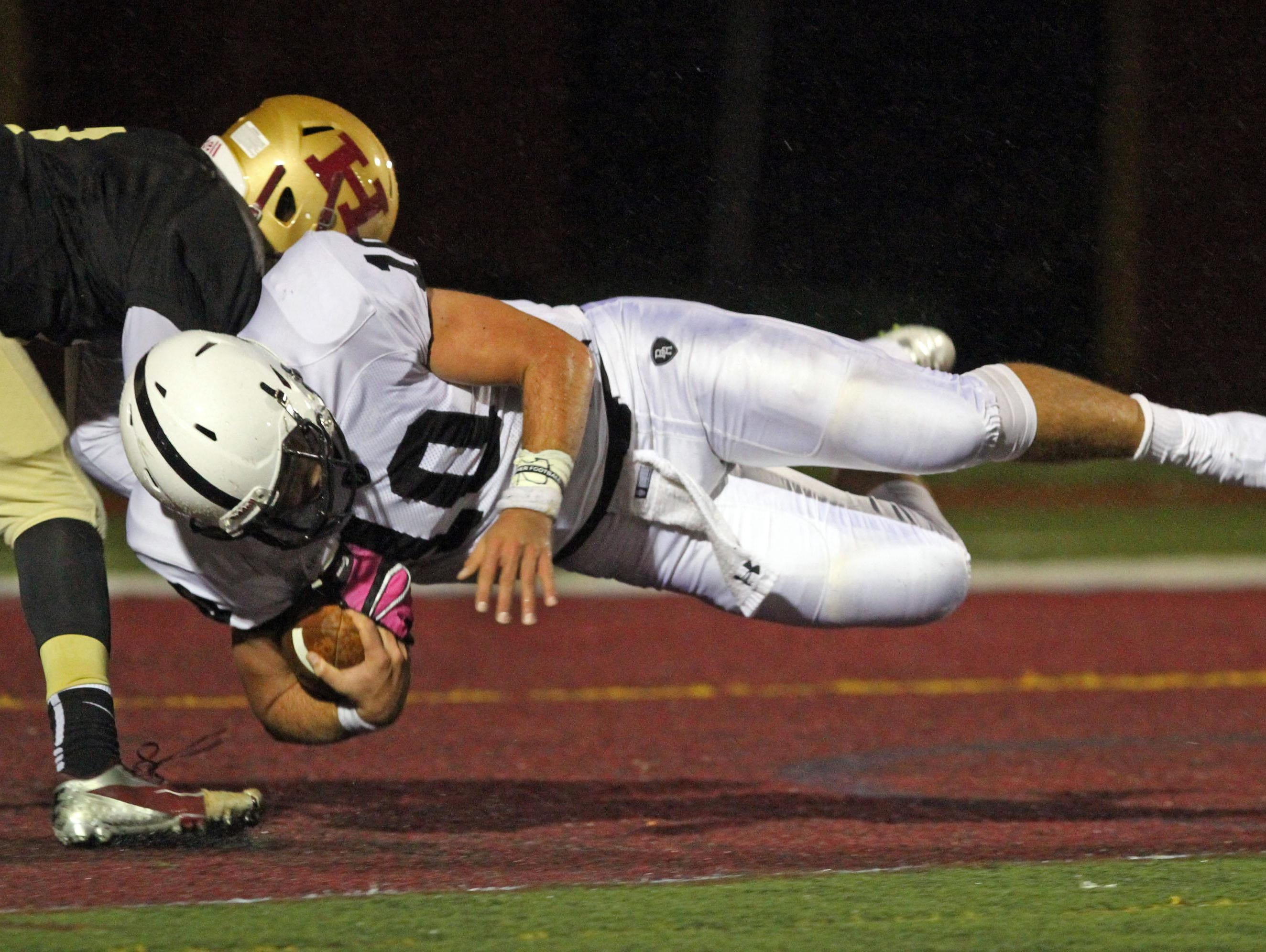 Bridgewater-Raritan quarterback Eric Nickel dives into the end zone to score the first touchdown of a game at the end of the first quarter at Hillsborough on Oct. 6.