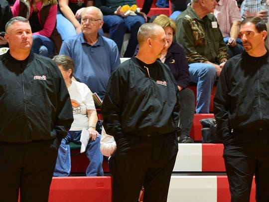 Jim Grafton, left, who is the deputy chief at the Battle Creek Police Department, teams up with Tim Rizor and Dave Eubank to referee high school basketball.