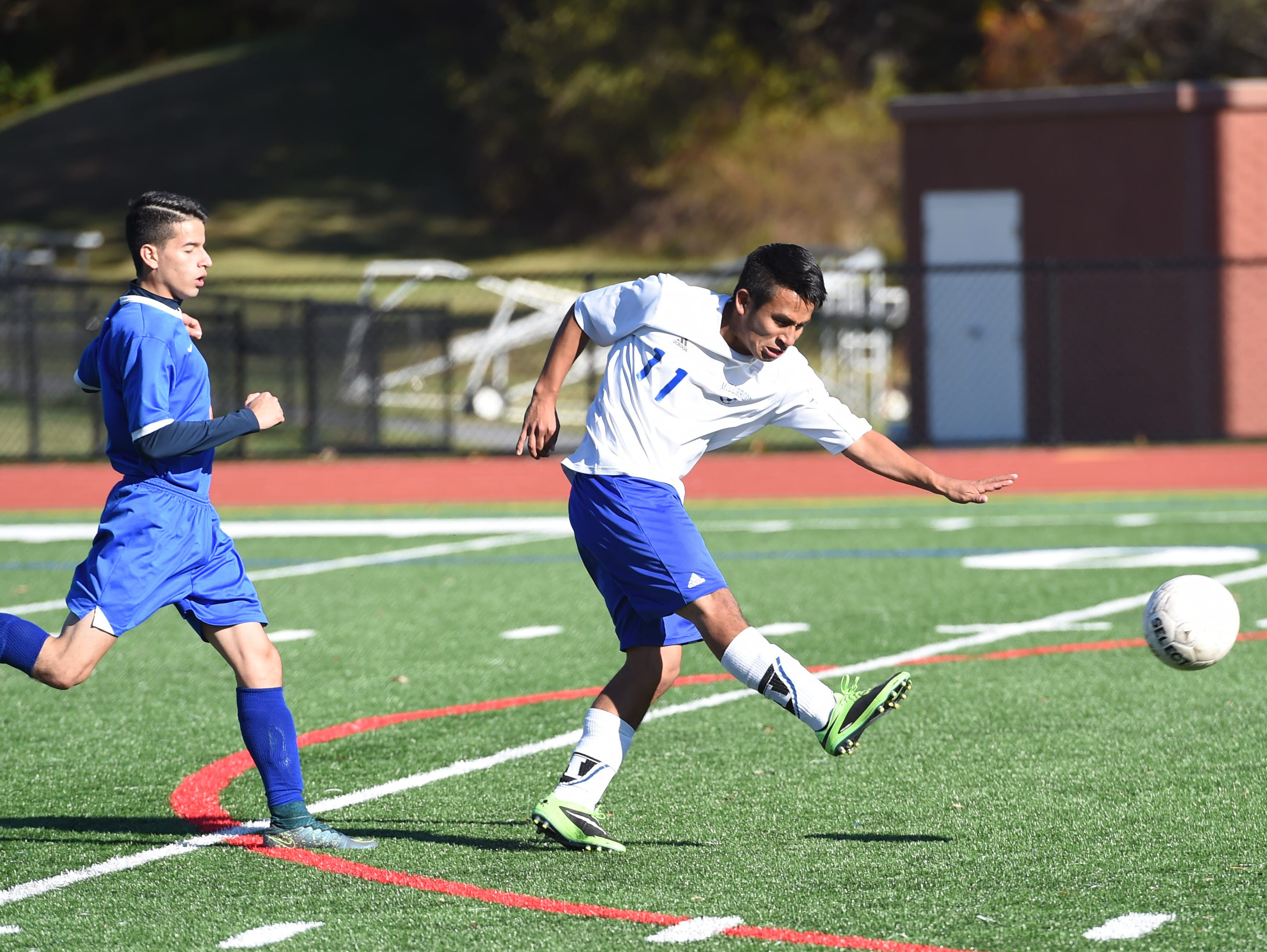 Millbrook's Bryan Oliveros Martinez takes a shot on goal after clearing Chester's Jimmy Cedeno during Monday's sectional semifinal game.