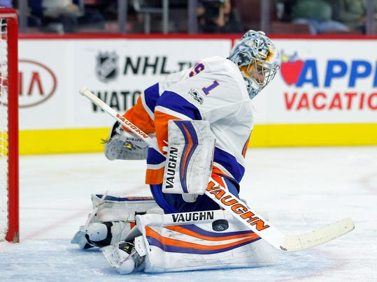 New York Islanders' Thomas Greiss deflects a shot on goal during the second period of an NHL preseason hockey game against the Philadelphia Flyers, Sunday, Oct. 1, 2017, in Philadelphia. (AP Photo/Tom Mihalek)
