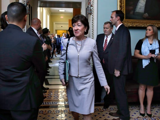 Sen. Susan Collins, R-Maine, center, leaves a meeting with Senate Republicans on Sept. 19, 2017, on Capitol Hill.