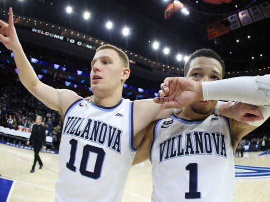 Villanova's Donte DiVincenzo, left, celebrates with Jalen Brunson, right, after the second half of an NCAA basketball game against Georgetown, Saturday, March 3, 2018, in Philadelphia. Villanova won 97-73. (AP Photo/Chris Szagola)
