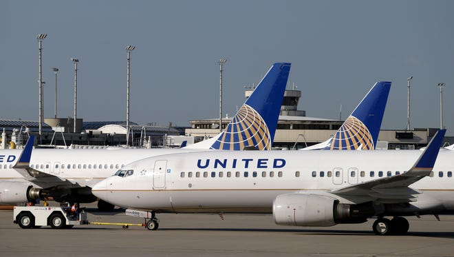 United Airlines planes are seen at Cleveland Hopkins International Airport on July 11, 2012.