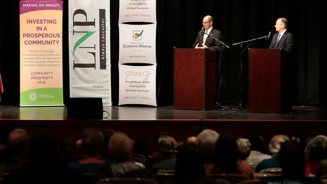 Republican Chet Beiler, and U.S. Representative Lloyd Smucker, R-Pa., answer questions from the moderators and audience members during a debate Monday, April 30, 2018, at Columbia High School.