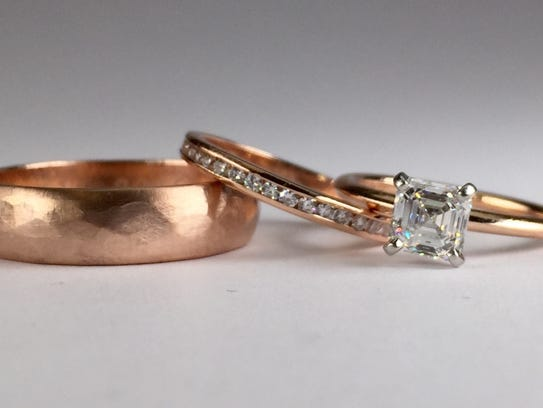 This set of bride and groom hand-forged rose gold rings