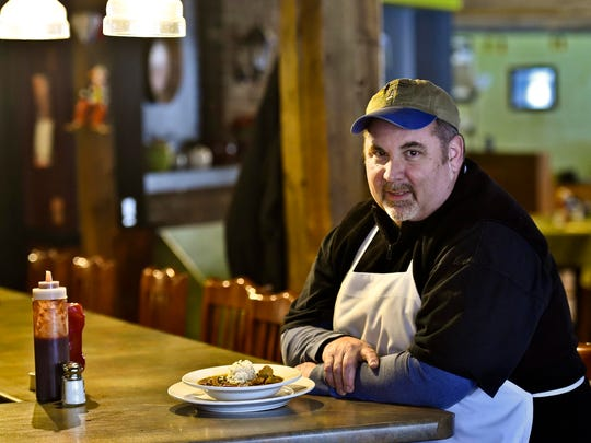 Tom Sullivan, chef and co-owner of the Cider House BBQ and Pub in Waterbury, with a bowl of his chicken and sausage gumbo, last week.
