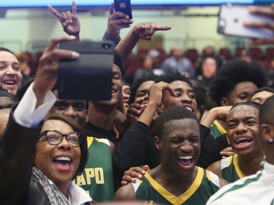 Ramapo players celebrate their emotional come from behind overtime victory against Mamaroneck in the boys Section 1 semifinal at the Westchester County Center in White Plains Feb. 28, 2018. Final score Ramapo-47 to Mamaroneck-40.