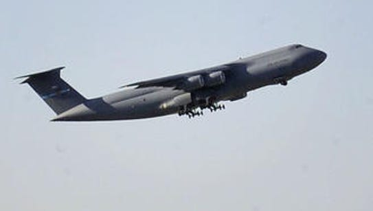 A plane takes off from Dover Air Force base. The Central
