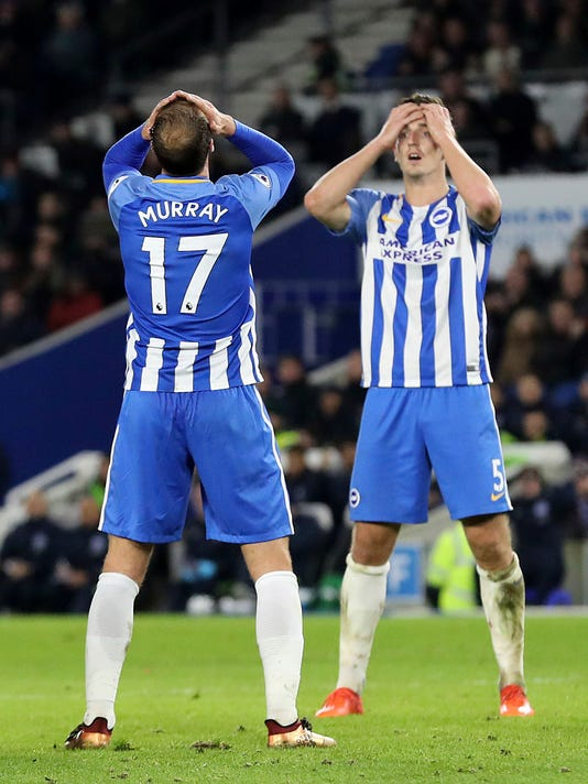 Brighton & Hove Albion's Glenn Murray, left, and Lewis Dunk look dejected after a missed chance during the English Premier League soccer match between Brighton & Hove Albion and Liverpool FC at the AMEX stadium, Brighton, England. Saturday. Dec. 2, 2017. (Gareth Fuller/PA via AP)