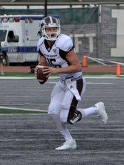 Western Michigan quarterback Jon Wassink looks for
