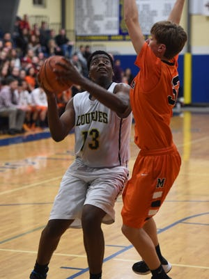 Our Lady of Lourdes High School's James Anozie looks to take a shot over a Marlboro defender during the 2015 Duane Davis Memorial Holiday Tournament at Lourdes.