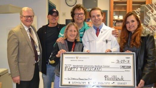 From left: Stuart Dill (VUMC Director of Engagement), Dave Robbins (BlackHawk / The Outlaws), Holly Crandall (VUMC), Henry Paul (BlackHawk / The Outlaws), Dr. Douglas Johnson (VUMC),  Lori Stefanski (Van Stephenson Memorial Cancer Research Fund Director of Charity)