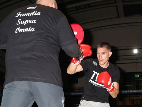 Liam Walsh works the pads during a recent training