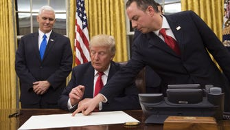 White House chief of staff Reince Priebus, at right, with President Trump and Vice President Pence.