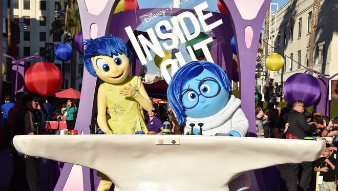 Joy and Sadness battle it out in 'Inside Out.'