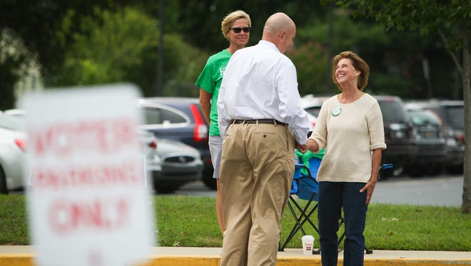 Janet Kilpatrick, Republican incumbent for the Third District seat on the New Castle County Council, greets Fred Cullis of Hockessin as he arrives at Linden Hill Elementary School Tuesday.