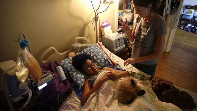 Angie Frank, a private duty nurse, cares for Jerika Bolen at the Bolens' Appleton home.