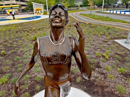 Wilma Rudolph is portrayed in one of the new bronze statues of iconic Indiana sports legends to be unveiled Tuesday, July 24, 2018, in the Riley Children's Health Sports Legends Experience area at the Children's Museum of Indianapolis.