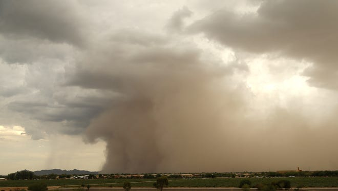 A dust storm comes through Gilbert on July 14, 2018.