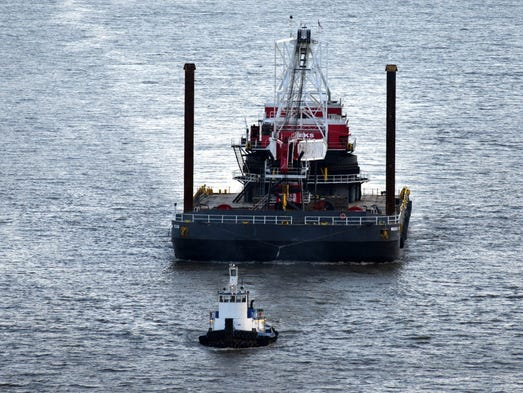 The tug boat Specialist is seen heading up-river on