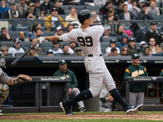 May 12, 2018; Bronx, NY, USA; New York Yankees right fielder Aaron Judge (99) hits a home run during the fifth inning of the game against the Oakland Athletics at Yankee Stadium.