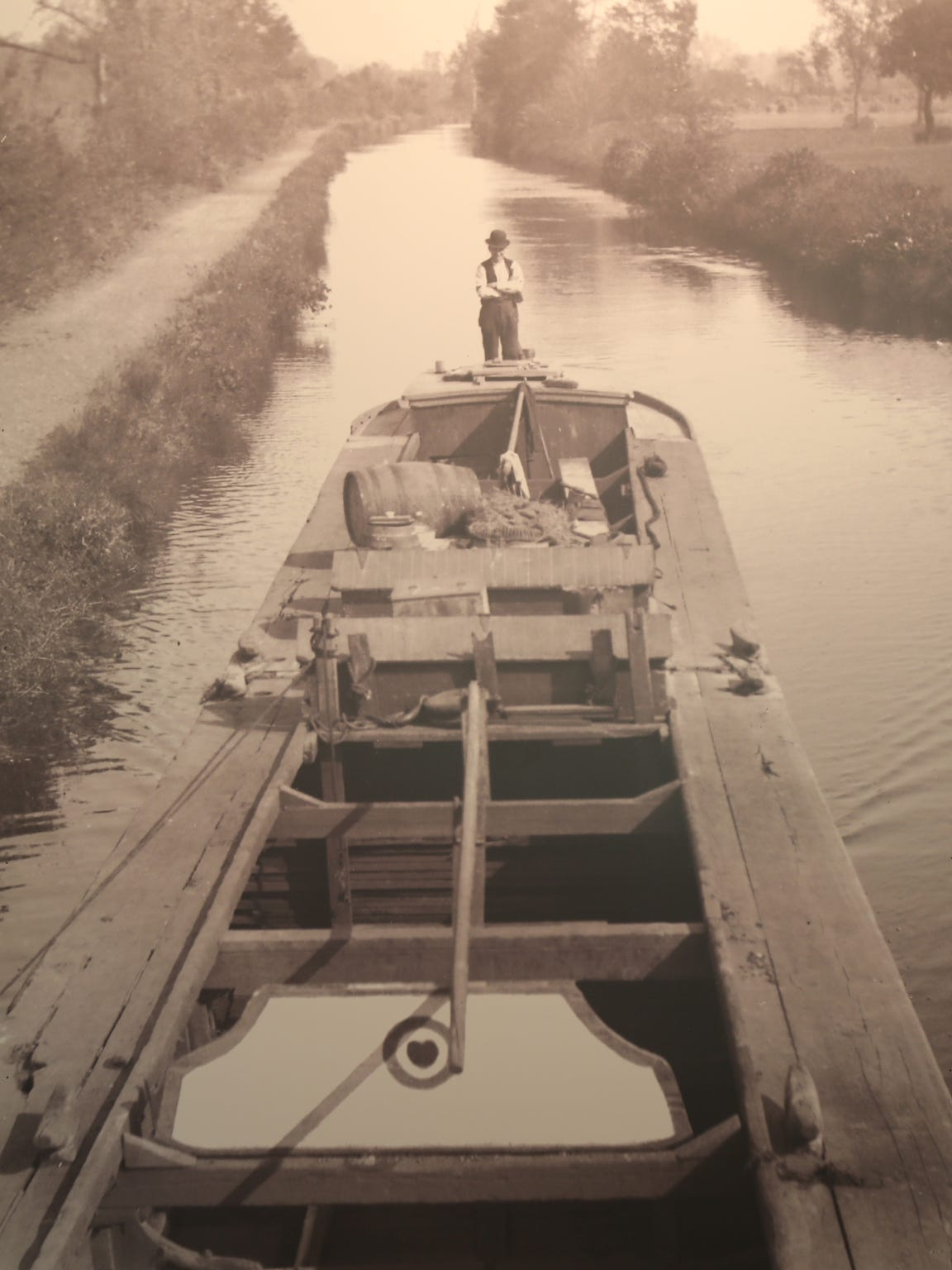 An old photo of a boat on the canal.