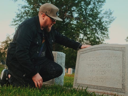 Jason Jones visits the grave of his late grandmother, Betty Jones. Betty Jones and her friend Kathryn Crigler were brutally attacked by an unknown assailant on Sept. 3, 1990, in Starkville. Their murders remain unsolved.
