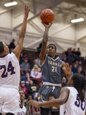 FILE – Warren Central senior Joe Rush (21) Joe Rush came off the bench to score 16 points in a win over Muncie Central last week.
