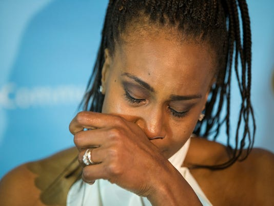 Retired Indiana Fever great Tamika Catchings becomes emotional, Saturday, June 24, 2017, in Indianpolis. The WNBA basketball team retired her jersey No. 24, at the Fever's game against the Los Angeles Sparks. (Robert Scheer/The Indianapolis Star via AP)