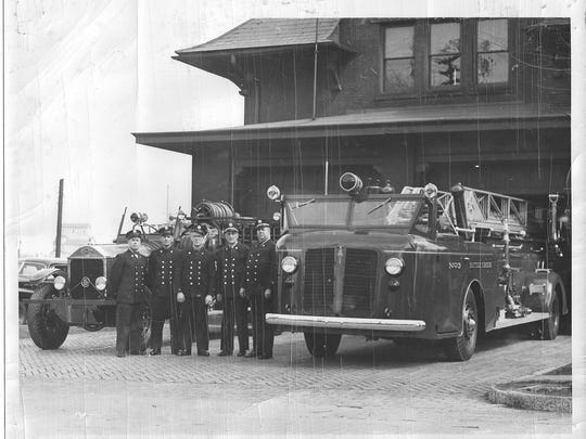 A photo from the 1940s shows off a 1942 fire truck, right, and one from 1929.