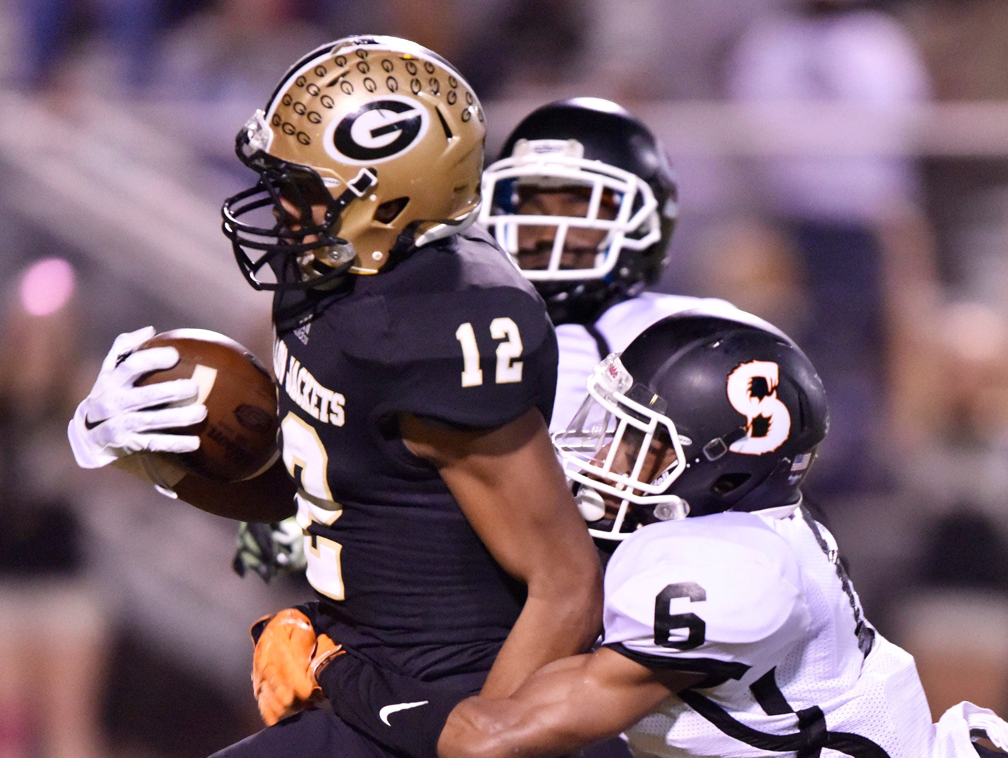 With Southside's Keenan Stephens (6) in tow, Greer's Dorian Lindsey (12) picks up a big gain.