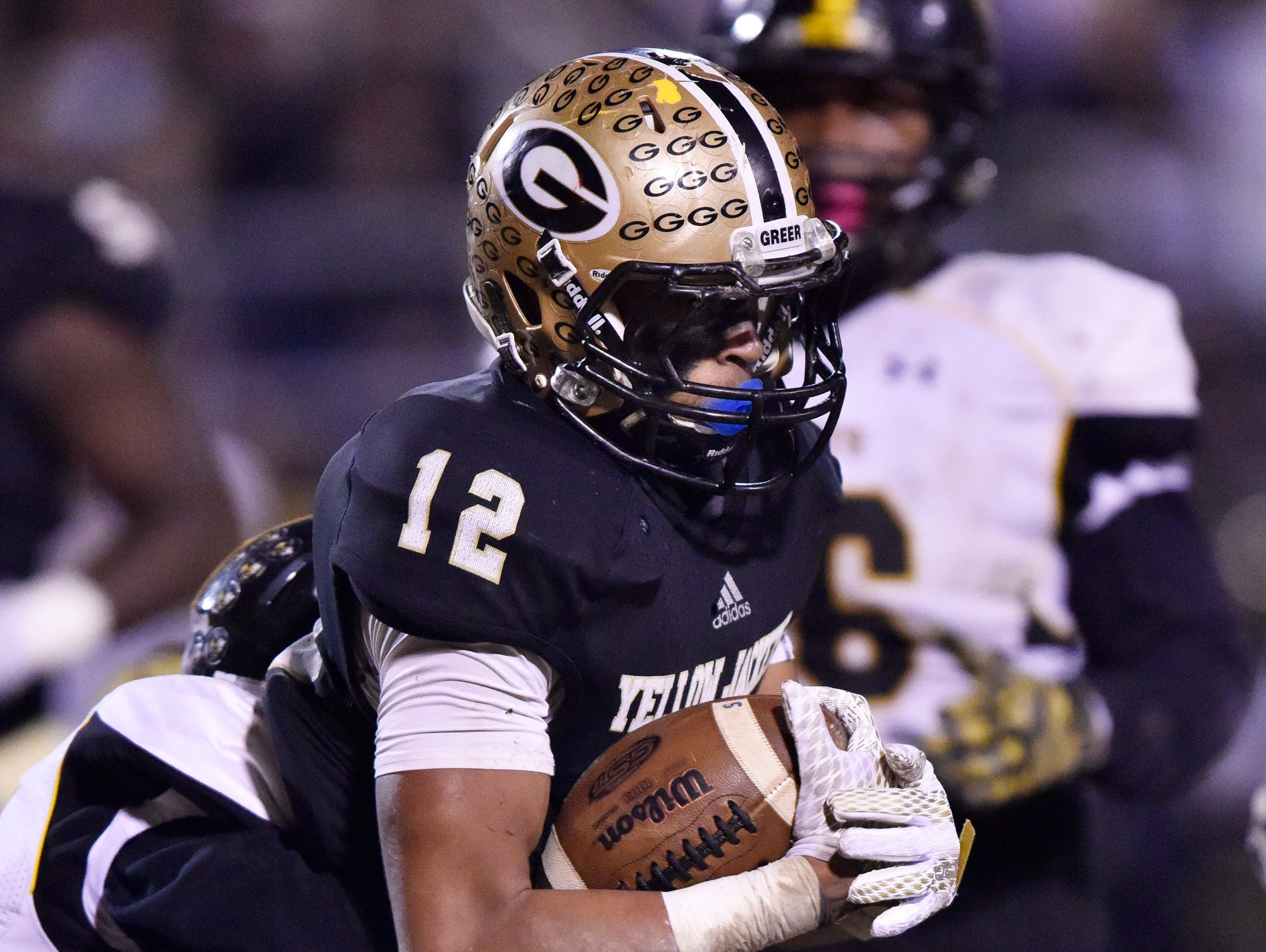 Greer's Dorian Lindsey (12) is caught by Union County tackler.
