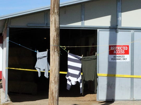 Yellow caution tape surrounds an entrance to a horse stable area Monday at Sunland Park Racetrack & Casino.  Racing has been suspended at Sunland Park since Jan. 22. Racing had been suspended at the track since Jan. 22, but will resume Feb. 26.