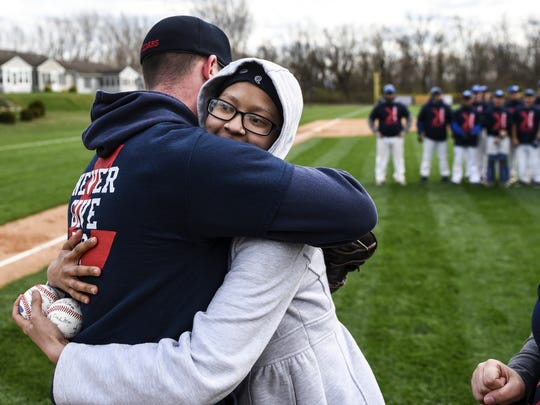 Lebanon baseball coach Mike Toomey and Arelis Rodriguez embrace at a fundraiser headed by Toomey to help Rodriguez battle stage IV neuroblastoma. The Lebanon School District, with aid from the Cocalico baseball team, raised $2,600 for Rodriguez's family.