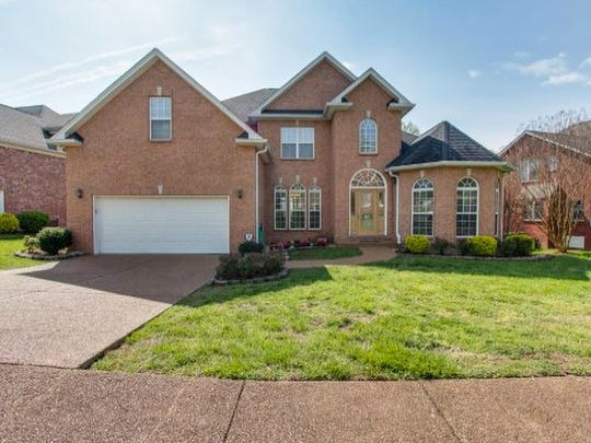 This four-bedroom home in Brentwood has hardwood floors